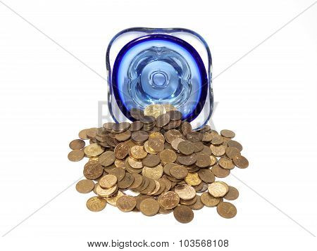 An overturned vase of small coins