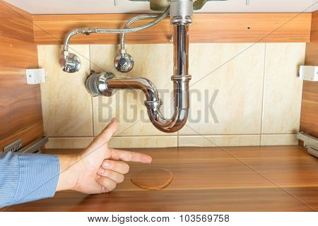 Flood  Under Drain Of Sink In Bathroom