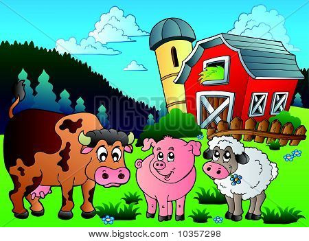 Three farm animals near barn