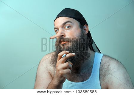 A smoking redneck questions his beliefs with liar nose