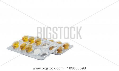 Yellow food supliment tablet with white background