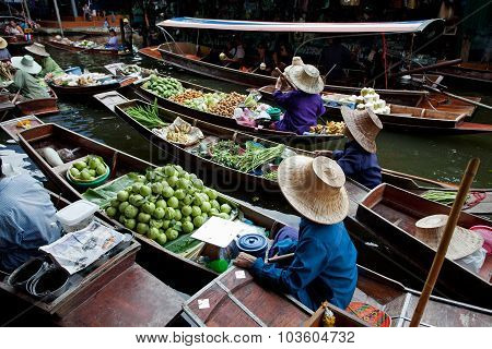 RATCHABURI THAILAND - AUGUST 28: Fruit boats at Damnoen Saduak floating market on August 28 2010 in
