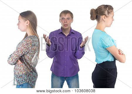 Confused young man and two women on white background poster