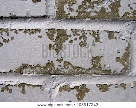 Weathered Brick Wall with Peeling Paint