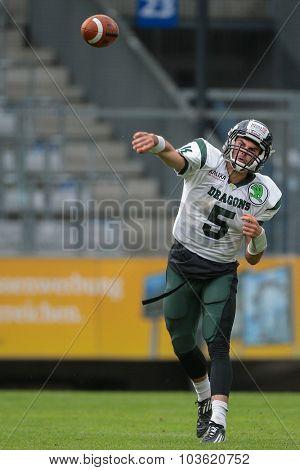 INNSBRUCK, AUSTRIA - JULY 12, 2014: QB Cary Grossart (#5 Dragons) passes the ball during an Austrian football league game.