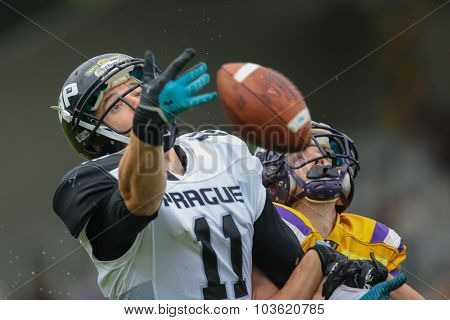 VIENNA, AUSTRIA - JULY 13, 2014: WR Jan Dundacek (#11 Panthers) reaches for the ball during an Austrian football league game.
