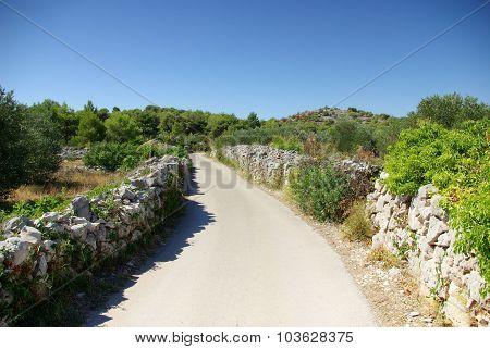Narrow Winding Asphalt Road Between The Rocks, Croatia Dalmatia