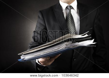 Businessman is Giving a lot of file