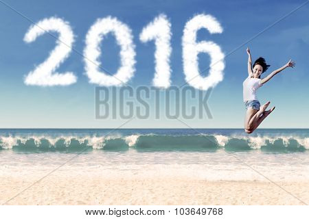 Attractive Woman Jumping At Coast With Numbers 2016