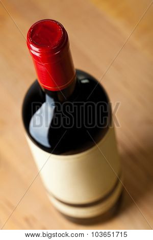Close up of a bottle of red wine from above