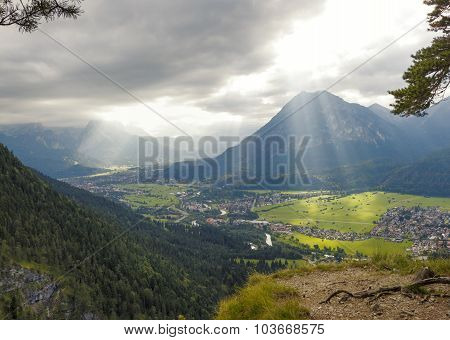 loisach valley from lookout point dramatic sky with sun rays. upper bavaria. poster