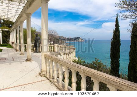 Antique style colonnade with Pushkin's statue. Aivazovsky park in Partenit, Crimea
