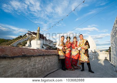 Tibetan couples in traditional costume are taken wedding photo in front of Potala palace in Lhasa, T