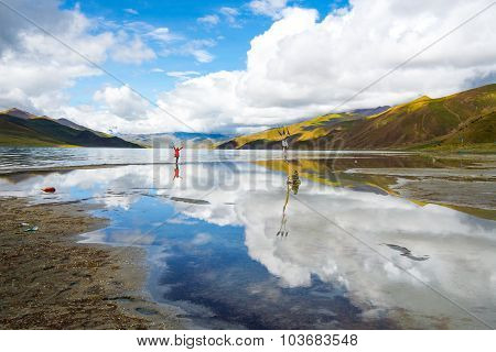 Traveler in Yamdrok lake in Tibet