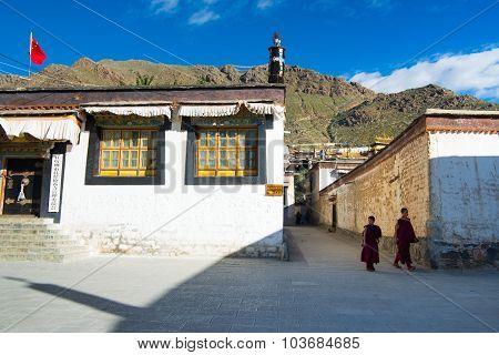Monks walk in Tashilhunpo monastery in Shigatse, Tibet.