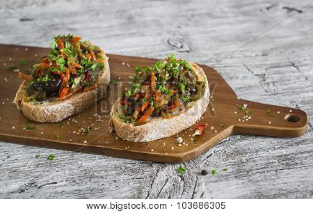 Sandwich With Baked Vegetable Relishes On A Light Wooden Surface