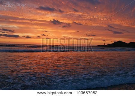 Glorious Sunset Over Lighthouse And Sea