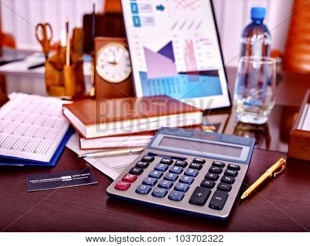 Business still life with calculator and clock on table in office.