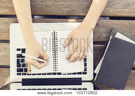 Girl Wrote In A Diary With Book And Laptop