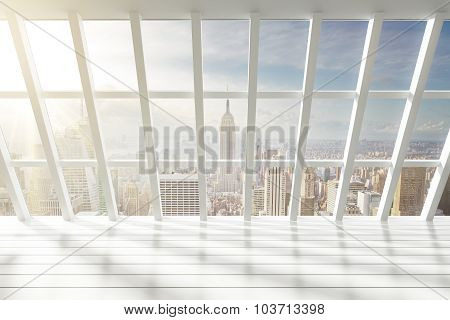 Beautiful Empty White Loft Interior With City View At Dawn