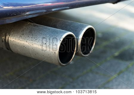 Dual Exhaust Of A Car, Concept For Emissions And Particulate Matter