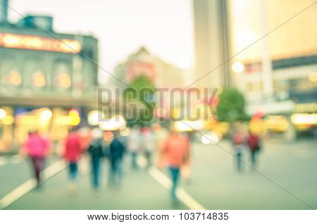 Blurred Defocused Background Of People Walking On The Road With Vintage Multicolored Filter