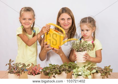 Fun And Funny Mom And Daughter Watered Flowers