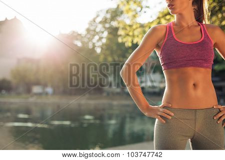 Young Woman In Sportswear With Fit Body
