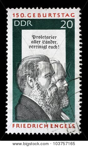 GDR - CIRCA 1970: a stamp printed in GDR shows Friedrich Engels and Karl Marx, Social Scientist, Political Theorist and Marxist, circa 1970
