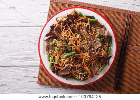 Chinese Noodles With Beef, Muer And Vegetables. Horizontal Top View