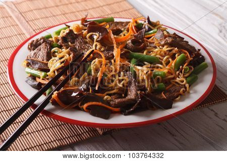 Chinese Lo Mein With Beef, Muer And Vegetables Close-up. Horizontal
