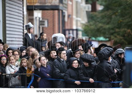 Community members watch from line