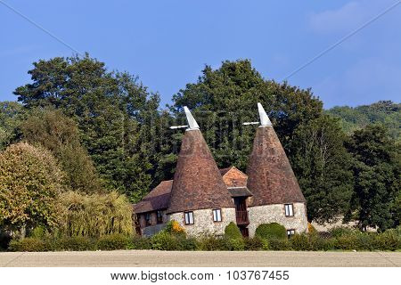 Old traditional Kentish round stone oast house