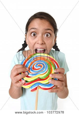 Child Holding Big Lollipop Licking With Tongue In Freak Crazy Funny Face Expression