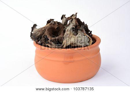 Craterellus Cornucopioides In Clay Bowl