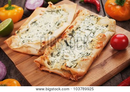 Phyllo pastry filled with cheese and spinach, traditional balkans fast food meal poster