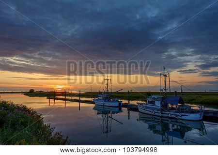 Picturesque view of the sunset and yachts, by the river