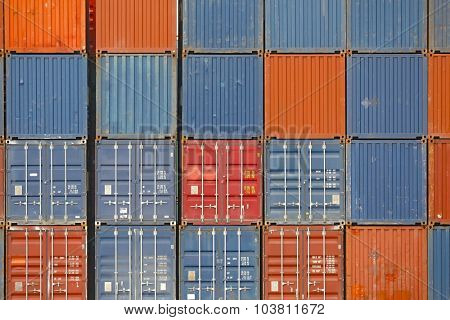 Stacked containers in a shipping terminal