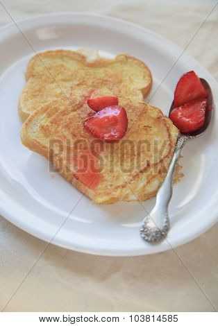 French toast and sweetened strawberries with copy space