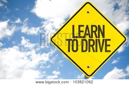 Learn To Drive sign with sky background