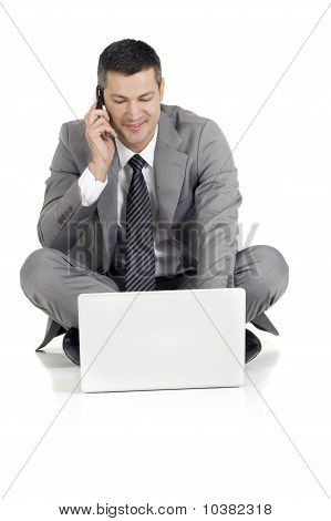 businessman with mobile and laptop isolated on white background