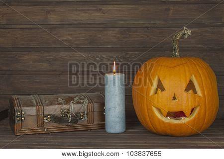 Halloween pumpkin head on wooden background. Preparing for Halloween.