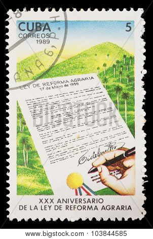 Postage Stamp Printed In Cuba Shows The Anniversary Of The Signature Of The Law Of Agrarian Reform