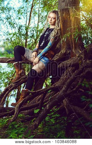 Attractive boho style girl in the wild wood. Boho, hippie fashion shot. poster