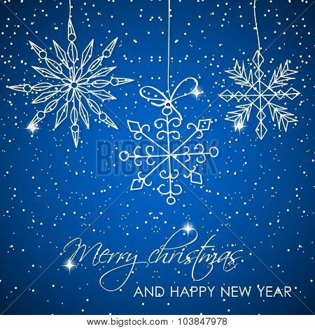 Abstract   christmas  background. Christmas Snowflakes and text on blue background. Christmas card design. Christmas poster, banner, card or web design with snowflake