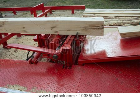 Woodworking the Machine Tool Wood factory Outdoors Close-up. Steel Band saw Machine working in Factory. Wood Shavings poster