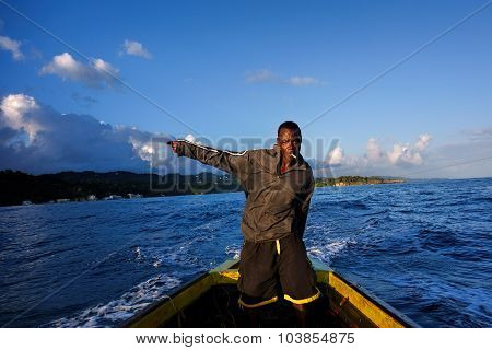 Jamaican fisherman in a wooden boat