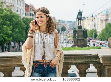 Hippie Woman In Bohemian Clothes Talking Cell Phone In Prague