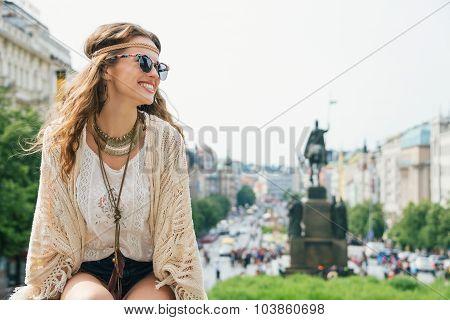 Trendy Hippie Woman Tourist Relaxing On Stone Parapet In Prague
