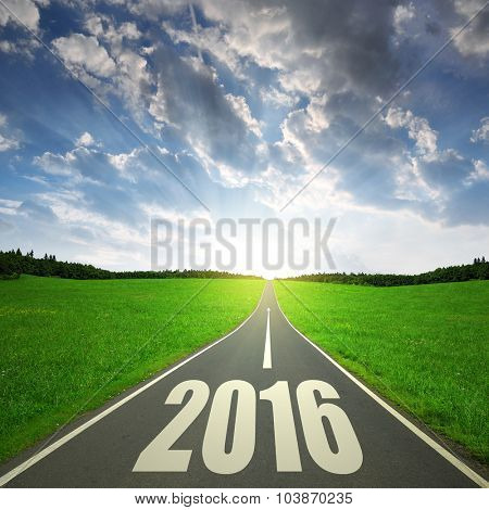 Asphalted road at sunset. Forward to the New Year 2016 poster